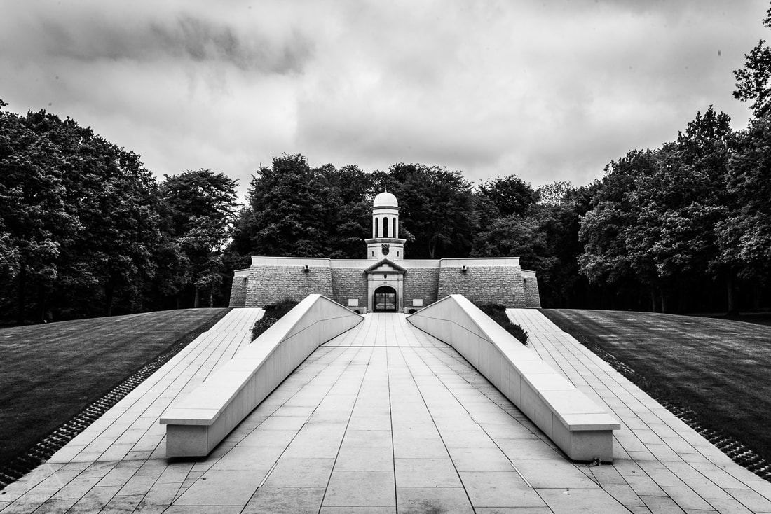 The South African memorial wall (Delville Wood,  Longueval) view towards the Museum.